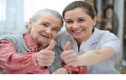 elderly-with-caregiver-thumbs-up